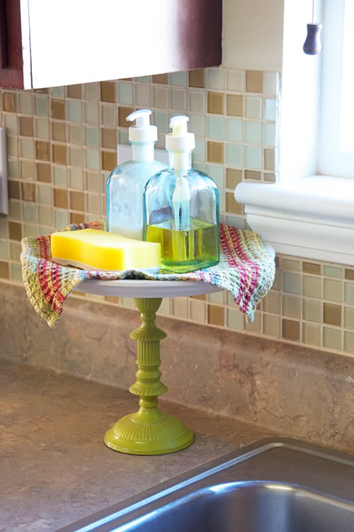 Use A Cake Stand To Hold Soap And Sponges Rather Than Leaving Them On The