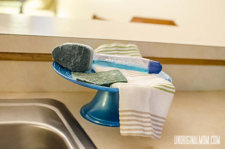 Use a cake stand to hold soap and sponges, rather than leaving them on the edge of the sink! | unOriginalMom.com