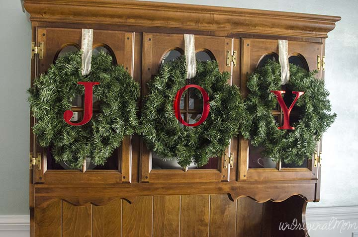 Simple, quick, and easy way to decorate your china cabinet for Christmas!