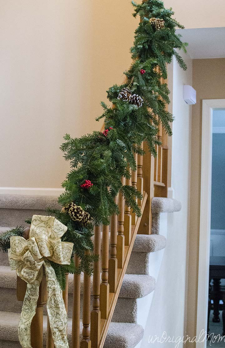 Make your own garland using cheap $2 garland strands from Walmart as a base and free clippings from the tree farm