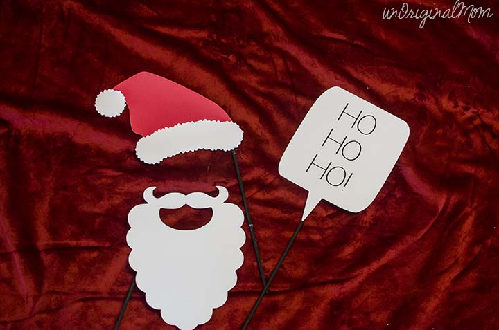 Christmas Photo Booth Props with FREE cut file from unOriginalMom.com #christmasparty #photoprops #silhouette