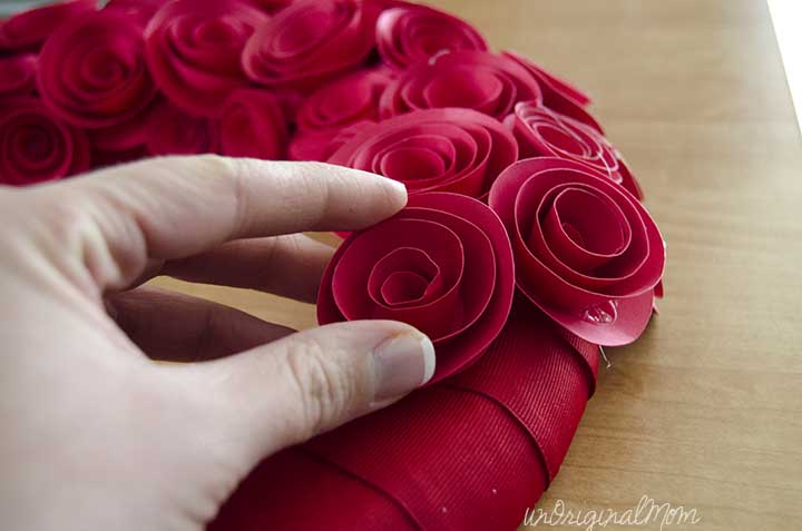 DIY Paper Rosette Wreath - includes free cut file for Silhouette users, but can also be made easily by hand!   #valentines #wreath #rosettes
