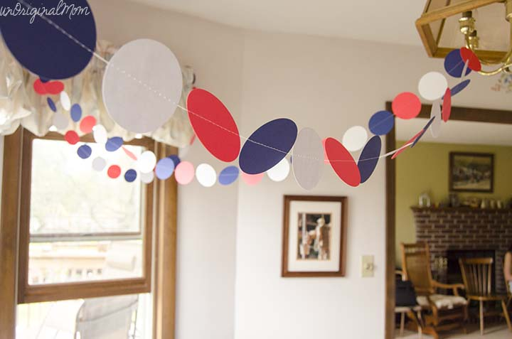 A super simple way to decorate for a party - cut out paper circles and sew them together with a sewing machine!