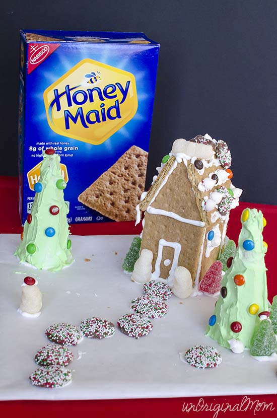 Don't forget about this fun holiday activity for your kids - make an easy gingerbread house out of graham crackers!