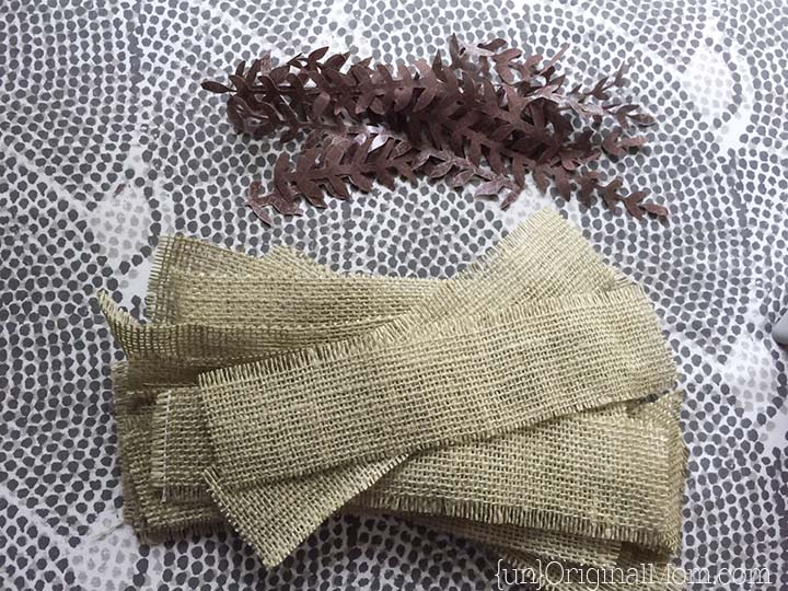 Step by step tutorial to create burlap wrapped votives with iron on fabric accents - perfect for a woodland wedding or shower