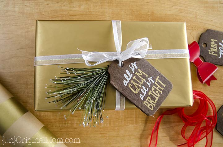 Rustic stained wood gift tags with metallic sharpie paint pens. A beautiful addition to holiday wrapping!