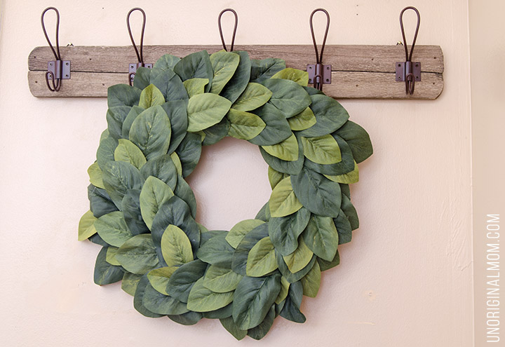 Great tutorial to make your own farmhouse style Magnolia Wreath for under $15! So much better than paying $100 for a store bought one. Love this Magnolia Market knockoff!