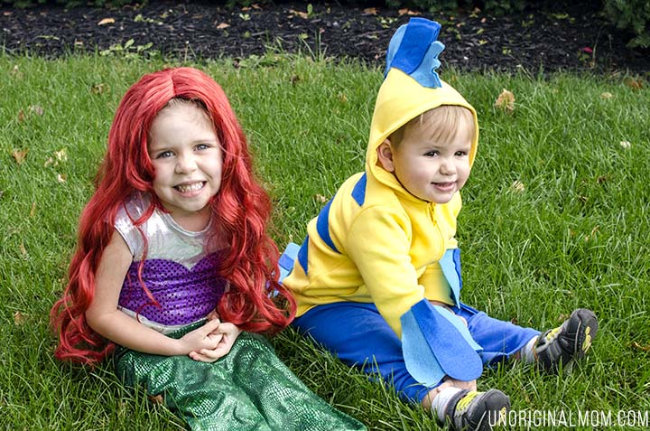 Adorable DIY Little Mermaid and Flounder costumes! The Ariel costume has a repositionable fin, and the no-sew toddler Flounder costume is super easy to make out of a yellow hoodie.