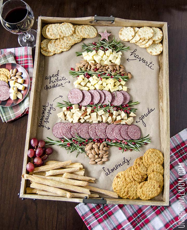 Create a Christmas tree cheeseboard for your holiday entertaining - it's so easy! What a beautiful way to do a holiday cheese tray!