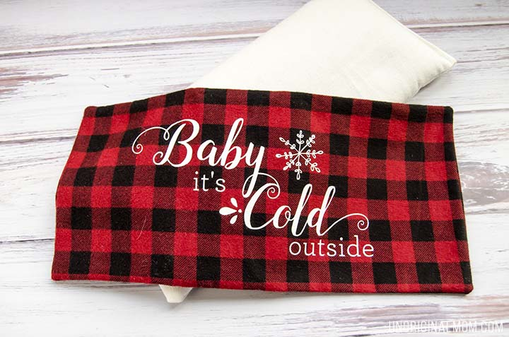 "Love this easy DIY gift idea - make a flax seed foot warmer out of cozy flannel and personalize it with HTV. Free ""Baby it's cold outside"" Silhouette cut file, too!"