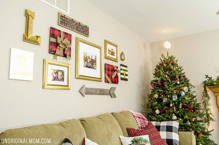 How to decorate a gallery wall for Christmas - great tips! I love the frames wrapped to look like gifts!