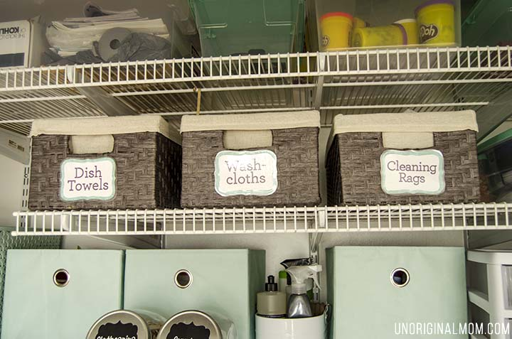 Organizing ideas and solutions for a small, multi-purpose laundry closet, complete with bins, labels, drawers, and even a pretty laundry sign!