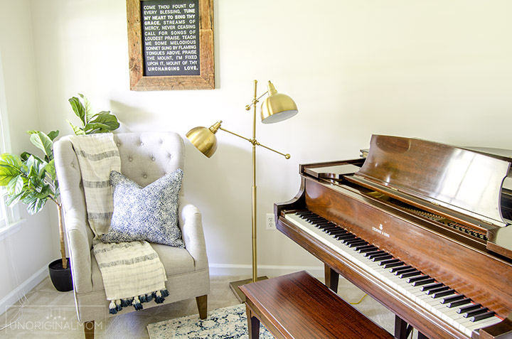 I love this pretty reading nook that's part of an industrial farmhouse music room/office! Plus a neat DIY farmhouse hymn sign. | industrial farmhouse | farmhouse hymn art | come thou fount sign | silhouette farmhouse wall art | one room challenge