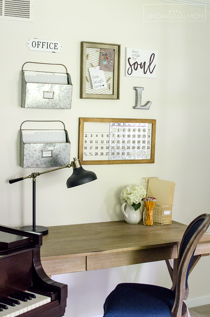 Beautiful Fixer Upper style industrial farmhouse office and music room makeover - includes pipe shelves, an office gallery wall, and lots of DIY farmhouse wall art! | One Room Challenge