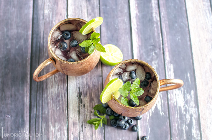 Blueberry Moscow Mule cocktail - a delicious summer drink made with blueberry simple syrup, lime juice, and ginger beer, and served in copper mugs. So refreshing and delicious! | blueberry cocktails | blueberry simple syrup | summer cocktail | summer drinks | copper mugs | blueberry moscow mule recipe