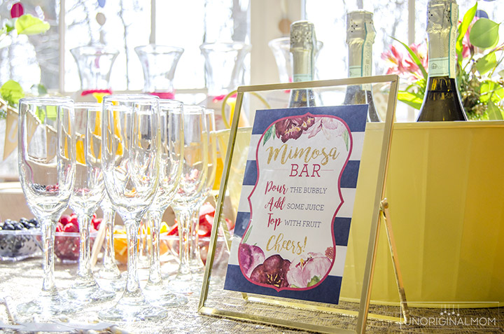 Great tips for how to put together a mimosa bar for a bridal shower or other event. It's easy and fun! | mimosa bar | mimosa bar printables | bridal shower brunch | bridal shower mimosa bar | brunch and bubbly | mimosa bar glasses | mimosa bar ideas