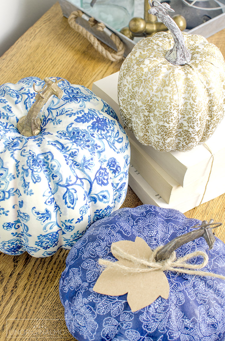 Create beautiful pumpkins for fall decor by covering them with fabric and mod podge. Perfect for any style of fall decor! | diy fabric covered pumpkins | fabric pumpkins | neutral fall decor | blue fall decor | mod podge fabric pumpkins |