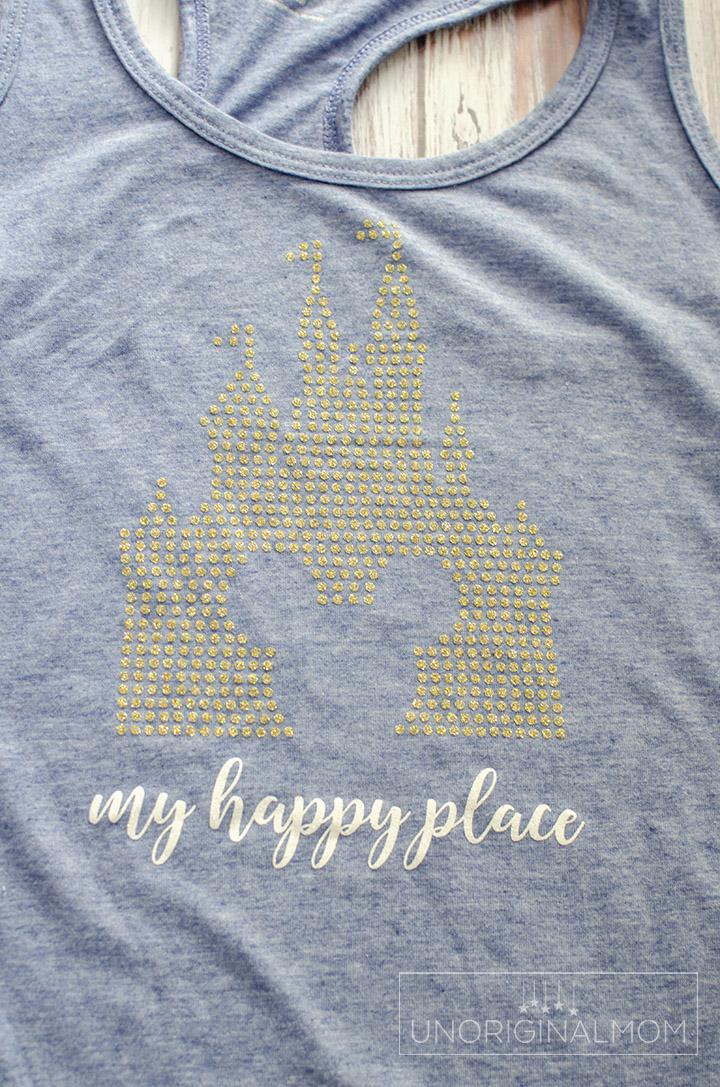 "DIY ""My Happy Place"" Disney tee made with glitter heat transfer vinyl. Free cut file, too! #disneyshirt #myhappyplace #freecutfile #silhouettecameo #htv #glitterhtv #diydisney"