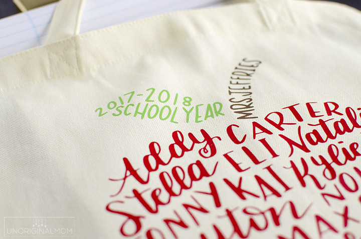 Such a meaningful end-of-the-year or teacher appreciation gift - a hand lettered class list in the shape of an apple, put on a tote bag with HTV! #teacherappreciation #silhouette #handlettering #teachergift