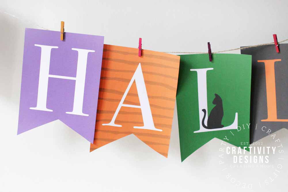 Super cute free printable Happy Halloween banner - perfect for Halloween parties! #halloween #printable #happyhalloween