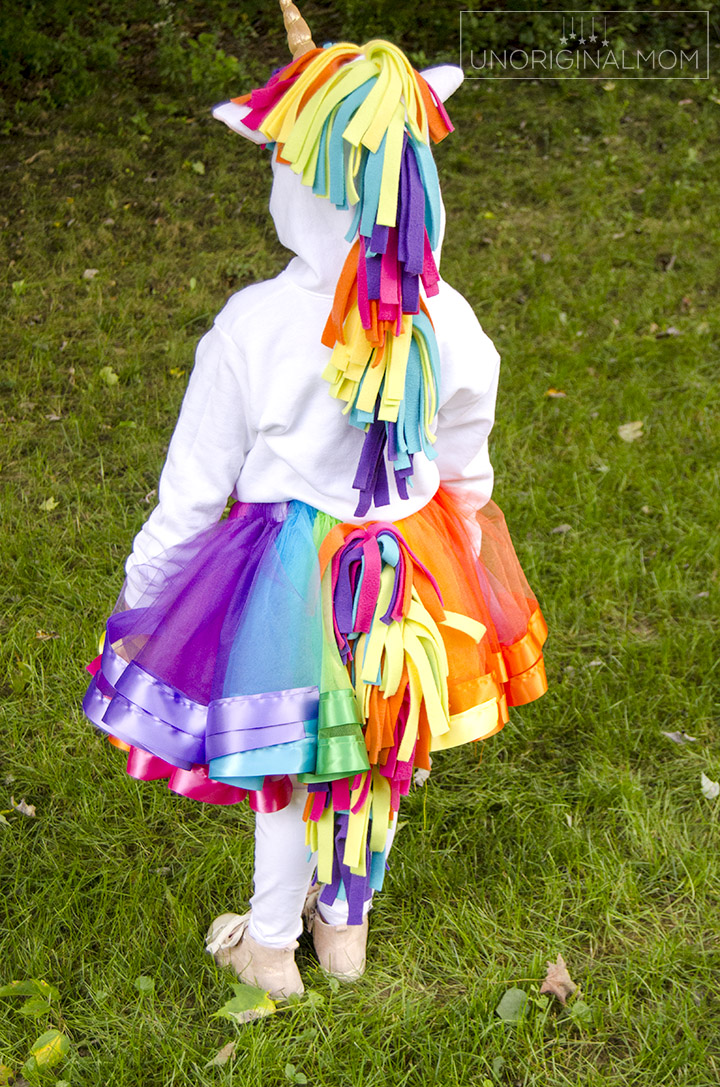 DIY Unicorn Hoodie Costume + Rainbow Tutu. Adorable unicorn costume made out of a hoodie! Love the rainbow tutu. Perfect for little girls. Make it no-sew by using hot glue instead! #unicorn #unicorncostume #easydiycostume