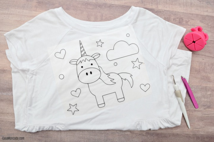 Make your own unicorn coloring shirt for kids with heat transfer vinyl and your Silhouette or Cricut! Super fun for party favors, or just because!