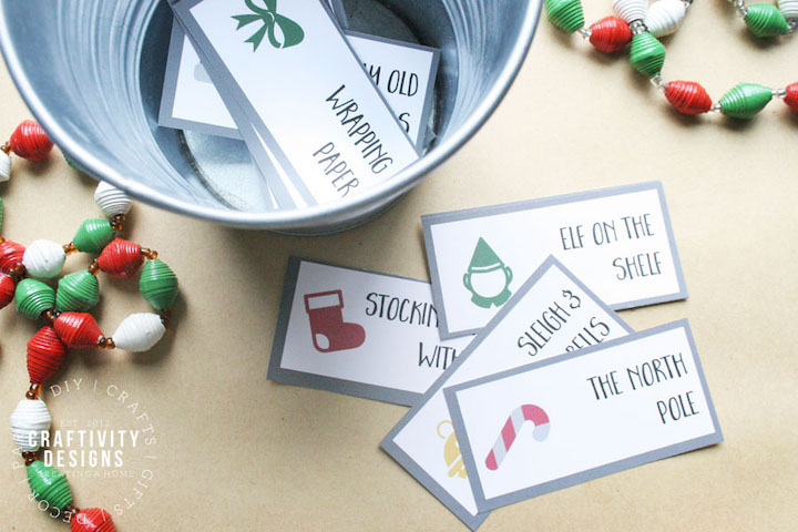 This free printable christmas charades game is an easy christmas game for christmas parties, or just to play at home with the family! #christmasgames #freeprintable #charades