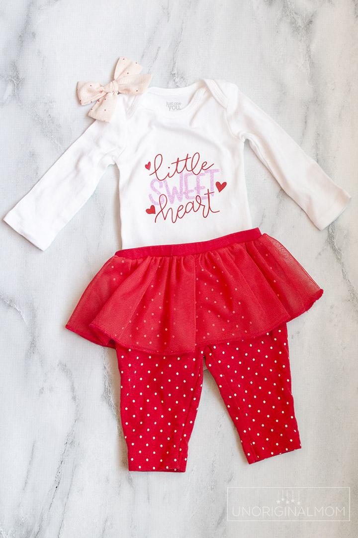 Little Sweet Heart Valentine's Onesie with a free cut file for Silhouette and Cricut! Use this adorable Valentine's onesie cut file to make a cute outfit for a little girl with glitter heat transfer vinyl.