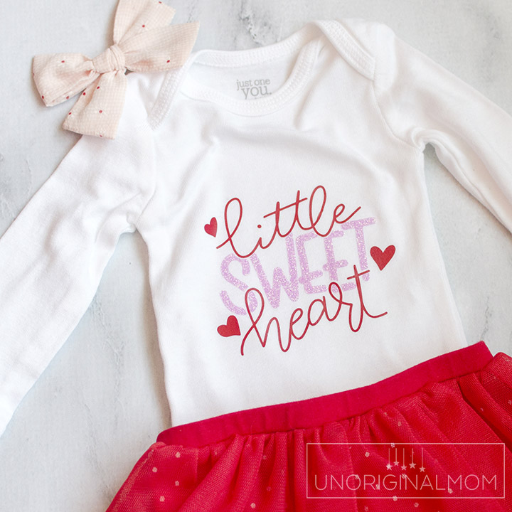 Little Sweet Heart Valentine's Onesie with a free cut file for Silhouette and Cricut! Adorable Valentine's Day onesie for a little girl with glitter heat transfer vinyl.