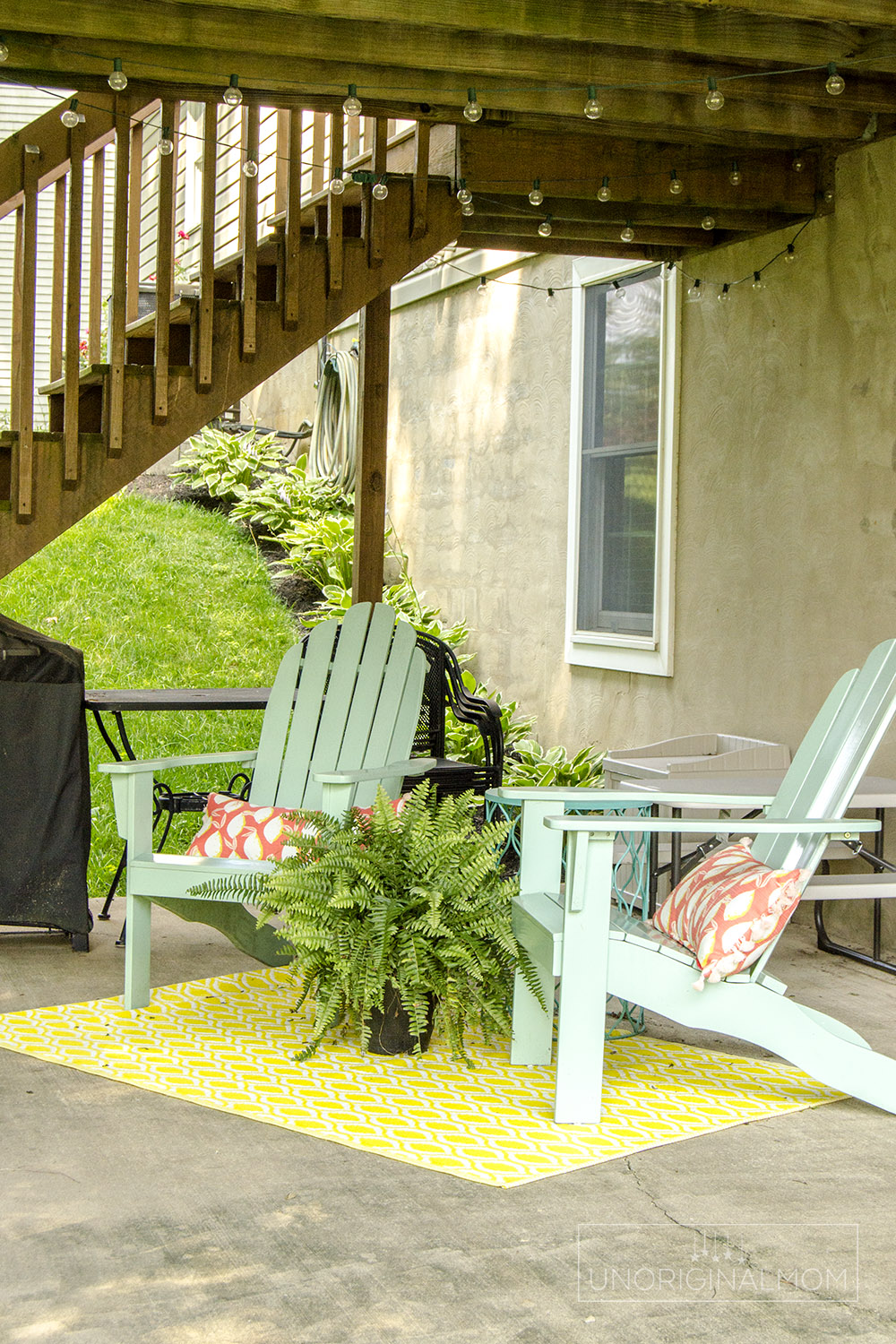 Seating area under the deck - great space for hanging out while the kids play! | walkout basement | under deck seating | small deck decorating ideas