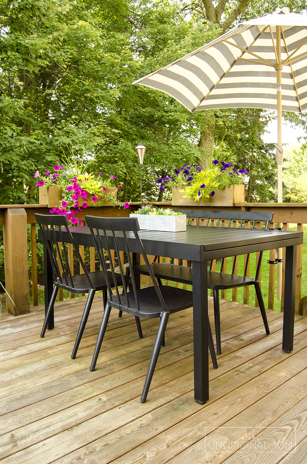 Deck dining area with a deck mounted umbrella - great way to save space on this small deck! | small deck decorating ideas