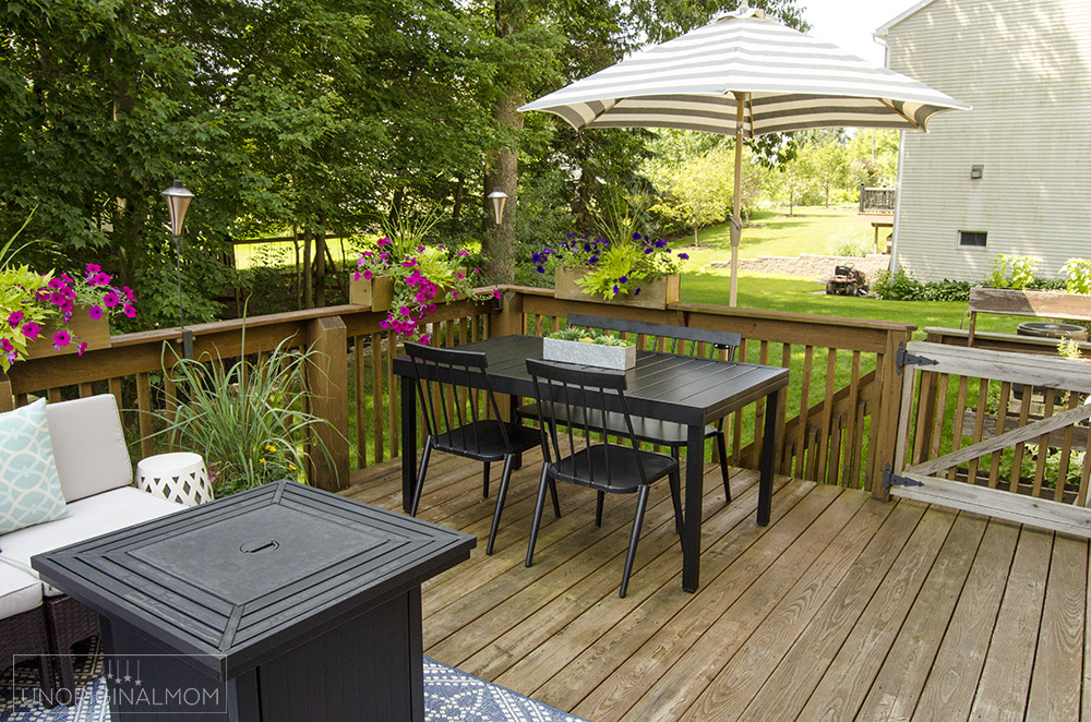 Modern black patio table with a butterfly leaf - great use of space on this small deck.