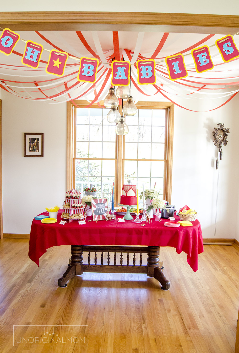 "Circus Baby Shower ideas - create a ""big top"" look over the table with crepe paper!"