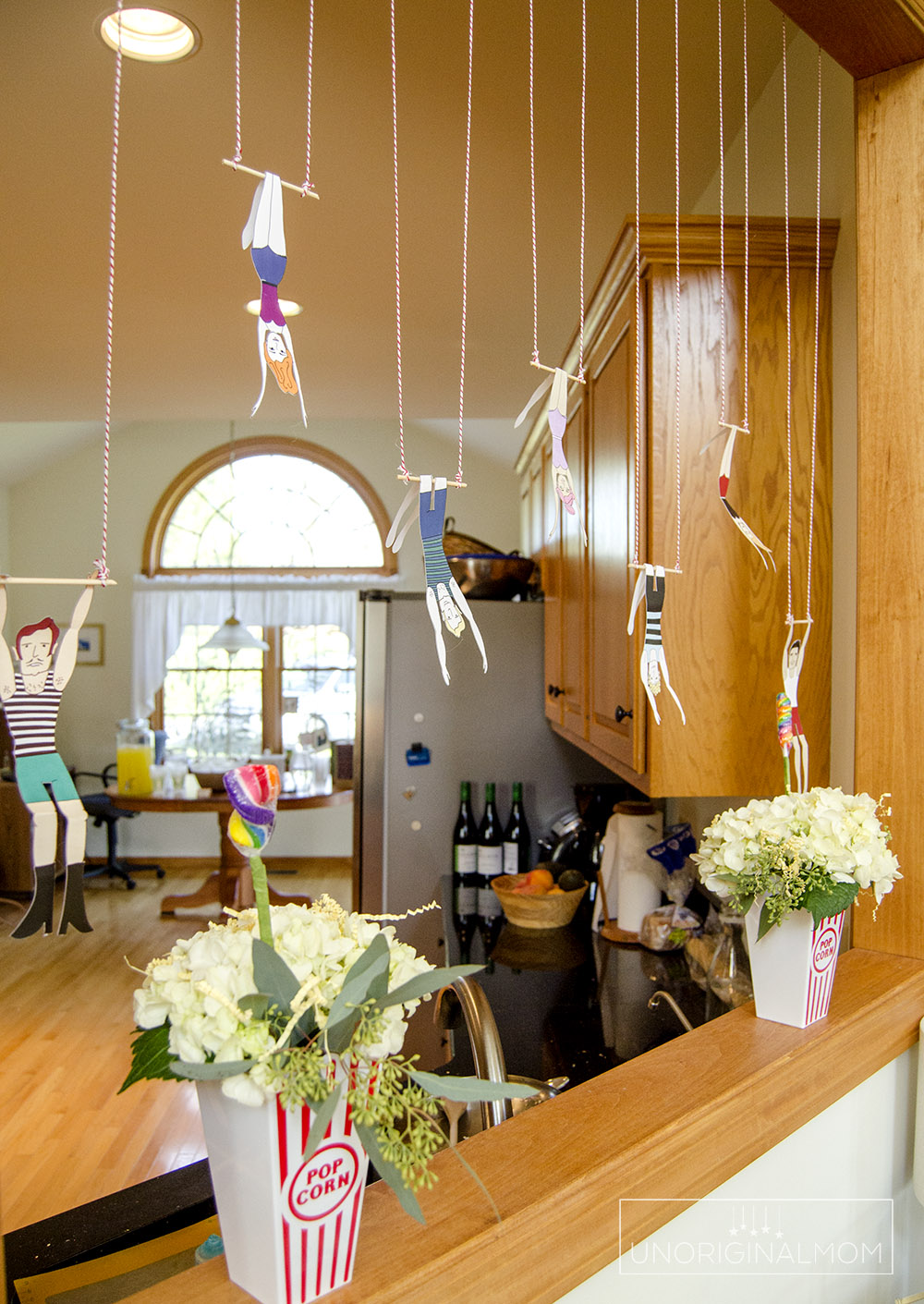 Circus Baby Shower ideas - hanging trapeze artists!