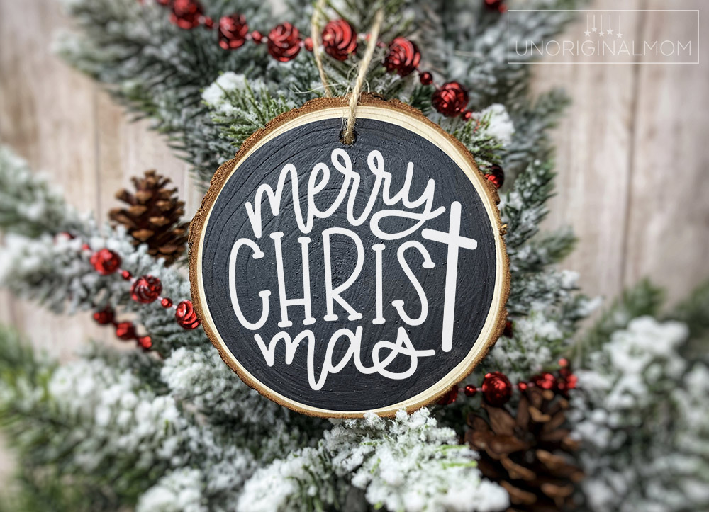 """Free Ornament SVGs, including this hand lettered """"Merry Christ-mas"""" ornament design, perfect for wood slice ornaments with vinyl."""