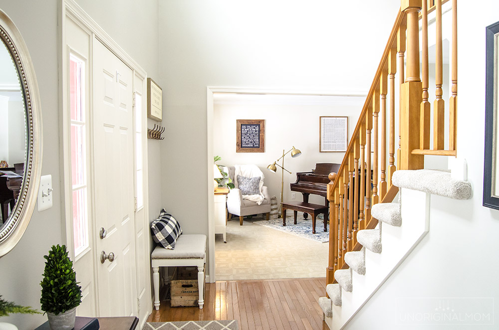 2 story foyer with bench and music room