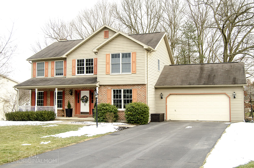 90s builder grade colonial with brick and tan siding