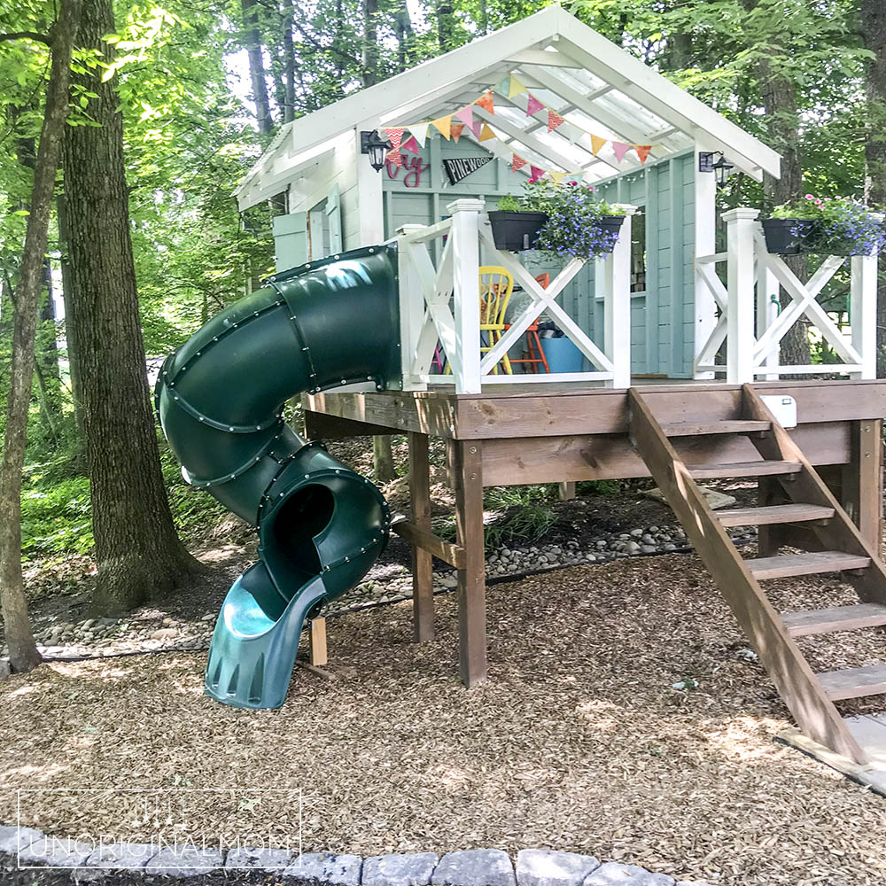 DIY backyard playhouse with curly tube slide