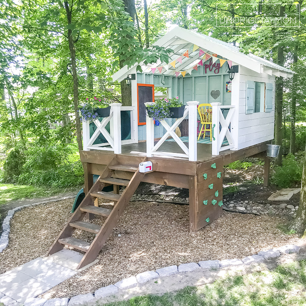 DIY Backyard Playhouse with Slide - this version of the Handmade Hideaway is a perfect raised playhouse for a sloped or wooded backyard! Playhouse landscaping ideas.